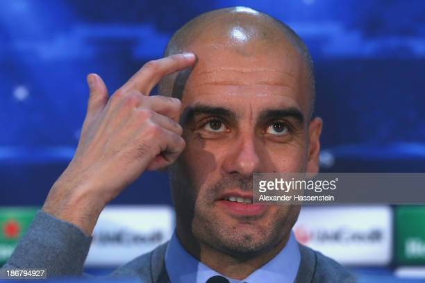 Pep Guardiola, head coach of FC Bayern Muenchen talks to the media during a press conference ahead of their Champions League group D match against...