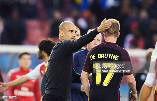 Pep Guardiola head coach of Manchester City and Kevin de Bruyne of Manchester City during the PreSeason Friendly between Arsenal and Manchester City...