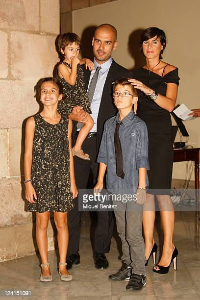 Pep Guardiola his wife Cris son Marius and daugthers Maria and Valentina attend the gold medal ceremony of honour as a recognition for his career and...