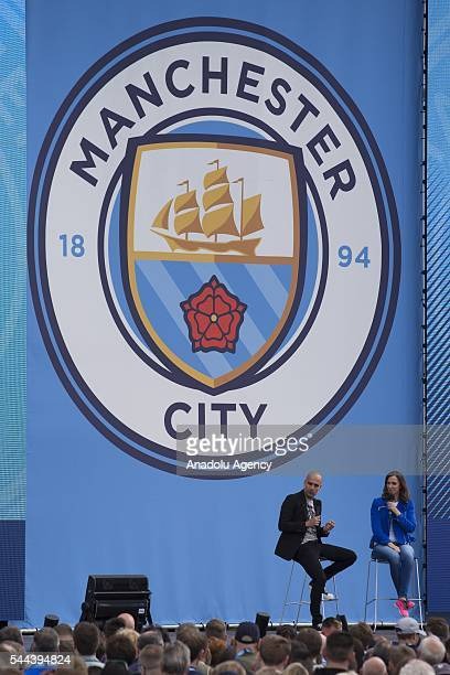 Pep Guardiola is interviewed on stage by television presenter Sally Nugent during the supporters event at the City Football Academy as he is...