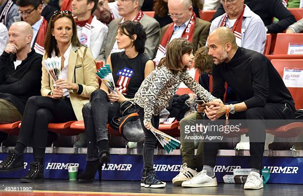 Pep Guardiola manager of Bayern Munich Football Club and his family watch the Euroleague Basketball match between Bayern Munich and Khimki Moscow...