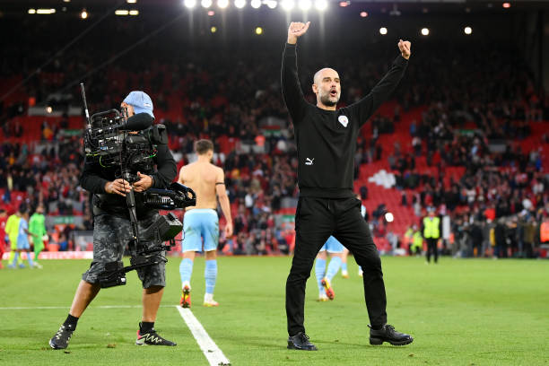 Pep Guardiola, Manager of Manchester City acknowledges the crowd after the Premier League match between Liverpool and Manchester City at Anfield on...