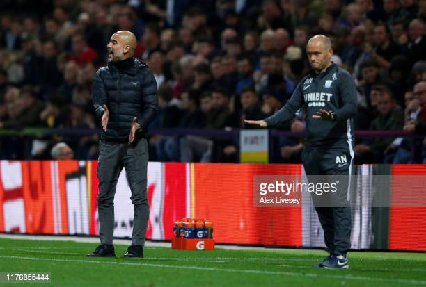 Pep Guardiola Manager of Manchester City and Alex Neil Manager of Preston North End give their team instructions during the Carabao Cup Third Round...