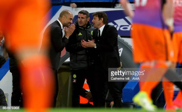 Pep Guardiola manager of Manchester City and Antonio Conte manager of Chelsea speak to each other during the Premier League match between Chelsea and...