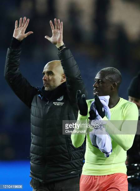 Pep Guardiola Manager of Manchester City and Benjamin Mendy applaud fans after the FA Cup Fifth Round match between Sheffield Wednesday and...