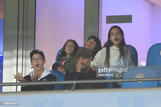 Pep Guardiola manager of Manchester City and his family react during the Group F match of the UEFA Champions League between Manchester City and...