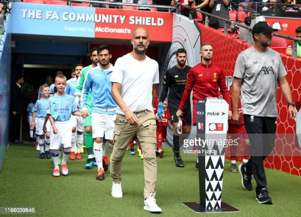 Pep Guardiola Manager of Manchester City and Jurgen Klopp Manager of Liverpool lead their players out of the tunnel prior to the FA Community Shield...