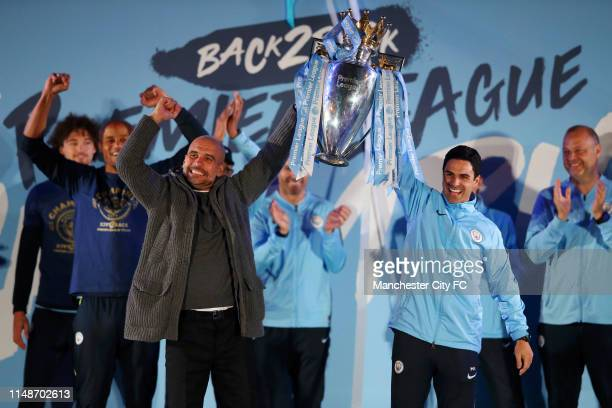 Pep Guardiola Manager of Manchester City and Mikel Arteta lift the trophy as they celebrate winning the Premier League Title in front of their fans...