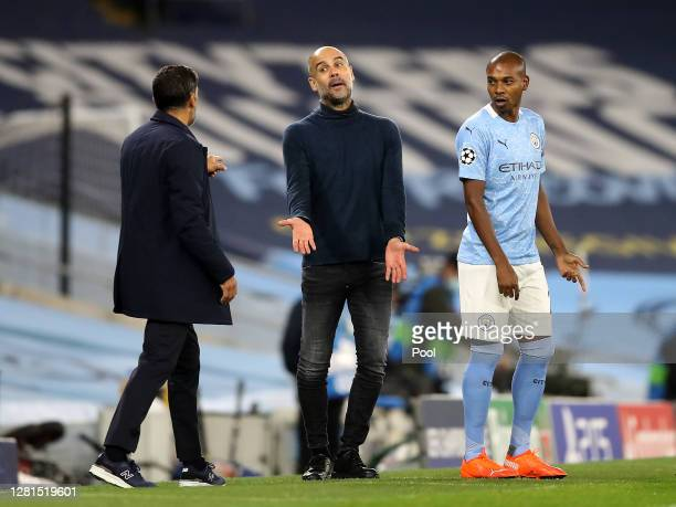 Pep Guardiola, Manager of Manchester City and Sergio Conceicao, Manager of FC Porto clash during the UEFA Champions League Group C stage match...