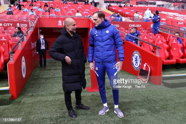 Pep Guardiola, Manager of Manchester City and Thomas Tuchel, Manager of Chelsea speak prior to the Semi Final of the Emirates FA Cup match between...