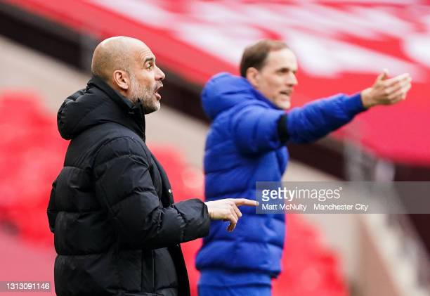 Pep Guardiola, manager of Manchester City and Thomas Tuchel, manager of Chelsea react during the Semi Final of the Emirates FA Cup match between...