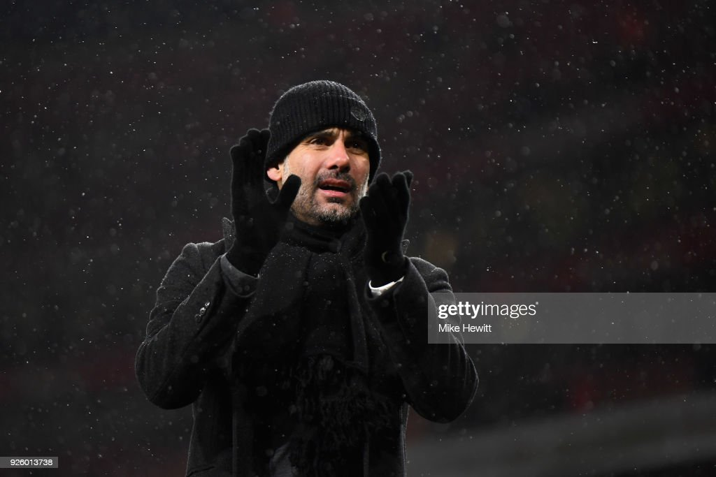 Pep Guardiola, manager of Manchester City applauds the fans after the Premier League match between Arsenal and Manchester City at Emirates Stadium on March 1, 2018 in London, England.