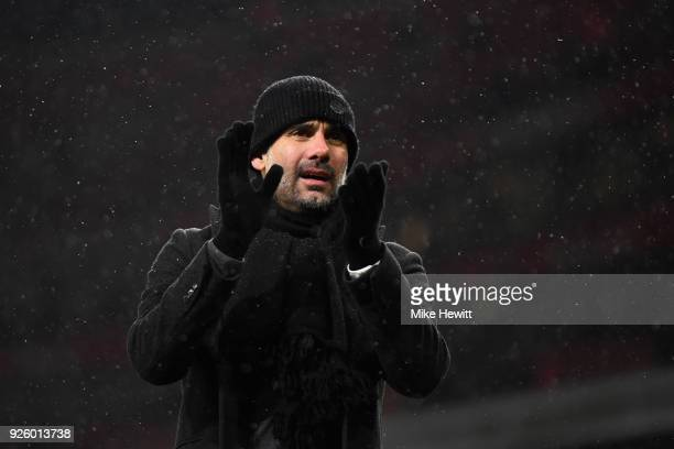 Pep Guardiola manager of Manchester City applauds the fans after the Premier League match between Arsenal and Manchester City at Emirates Stadium on...