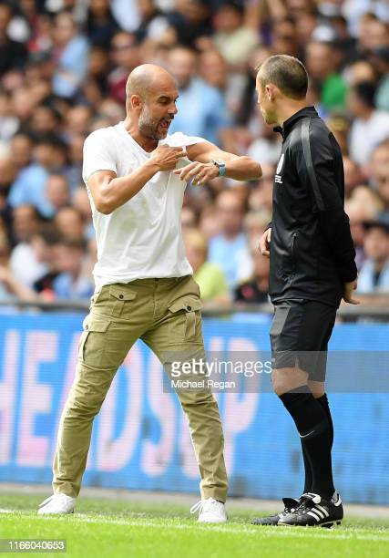 Pep Guardiola Manager of Manchester City argues with the fourth official during the FA Community Shield match between Liverpool and Manchester City...