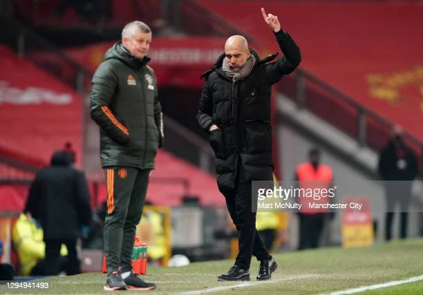 Pep Guardiola, Manager of Manchester City celebrates as Ole Gunnar Solskjaer, Manager of Manchester United looks on during the Carabao Cup Semi Final...