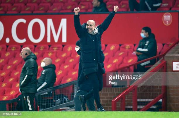 Pep Guardiola, Manager of Manchester City celebrates during the Carabao Cup Semi Final match between Manchester United and Manchester City at Old...