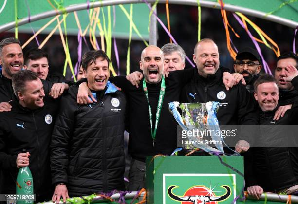 Pep Guardiola, Manager of Manchester City celebrates following his sides victory in the Carabao Cup Final between Aston Villa and Manchester City at...
