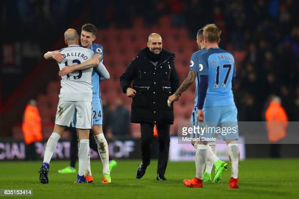 Pep Guardiola manager of Manchester City celebrates victory with his players after the Premier League match between AFC Bournemouth and Manchester...