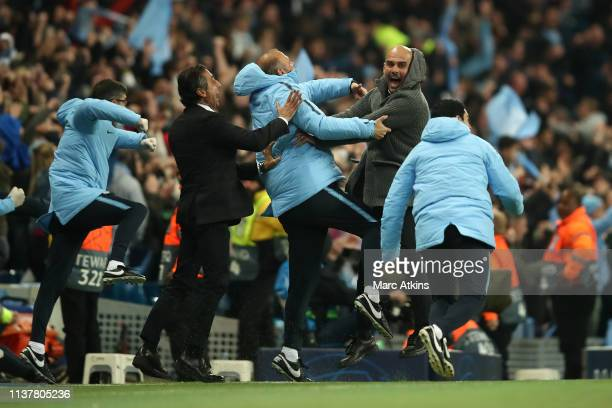 Pep Guardiola manager of Manchester City celebrates with his coaching staff before a goal from Raheem Sterling of Manchester City is ruled out for...
