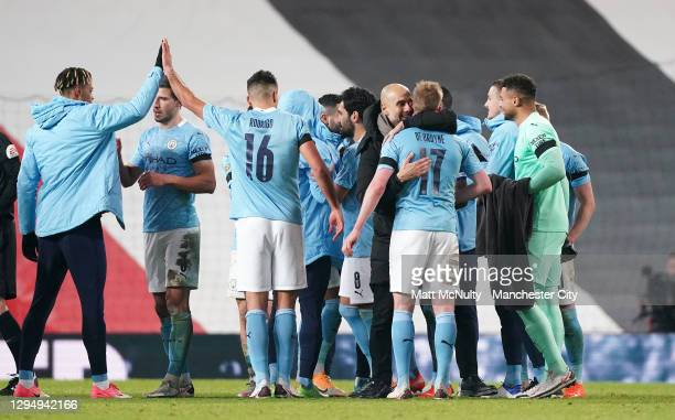 Pep Guardiola, Manager of Manchester City celebrates with his team and Kevin De Bruyne of Manchester City after the Carabao Cup Semi Final match...