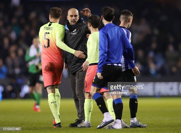 Pep Guardiola Manager of Manchester City celebrates with John Stones and Bernardo Silva of Manchester City following their victory in the FA Cup...