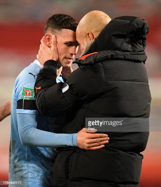 Pep Guardiola, Manager of Manchester City celebrates with Phil Foden of Manchester City after the final whistle during the Carabao Cup Semi Final...