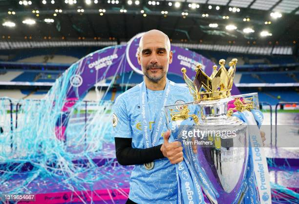 Pep Guardiola, Manager of Manchester City celebrates with the Premier League Trophy as Manchester City are presented with the Trophy as they win the...