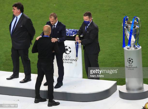 Pep Guardiola manager of Manchester City collects his runners up medal from UEFA President Aleksander Ceferin during the UEFA Champions League Final...