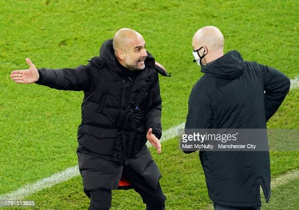 Pep Guardiola, manager of Manchester City complains to fourth official Anthony Taylor the during the Premier League match between Manchester City and...