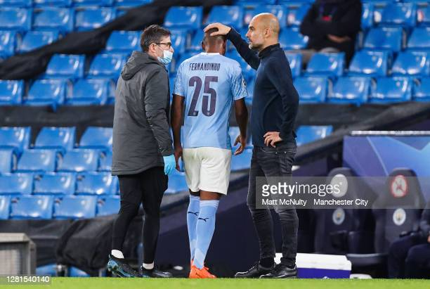 Pep Guardiola, manager of Manchester City consoles Fernandinho during the UEFA Champions League Group C stage match between Manchester City and FC...