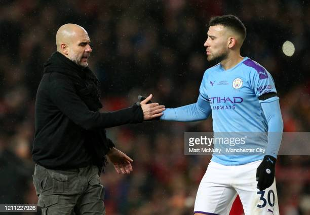 Pep Guardiola Manager of Manchester City consoles Nicolas Otamendi of Manchester City at full time during the Premier League match between Manchester...