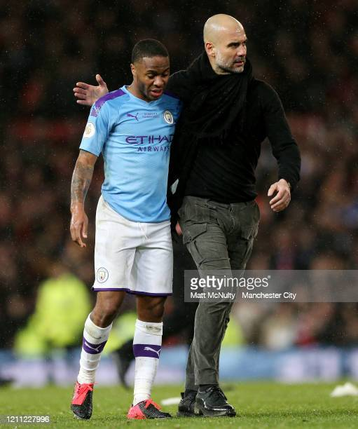 Pep Guardiola Manager of Manchester City consoles Raheem Sterling of Manchester City at full time during the Premier League match between Manchester...