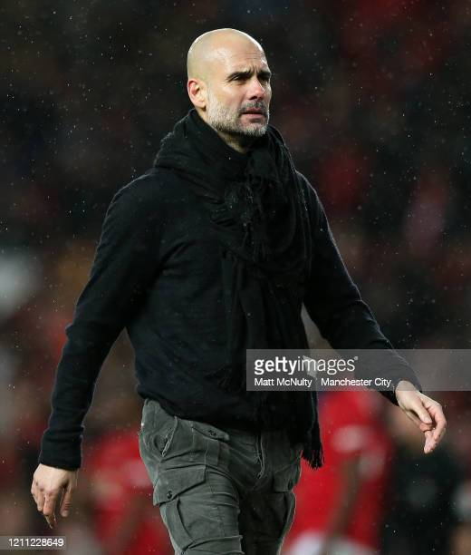 Pep Guardiola Manager of Manchester City during the Premier League match between Manchester United and Manchester City at Old Trafford on March 08...