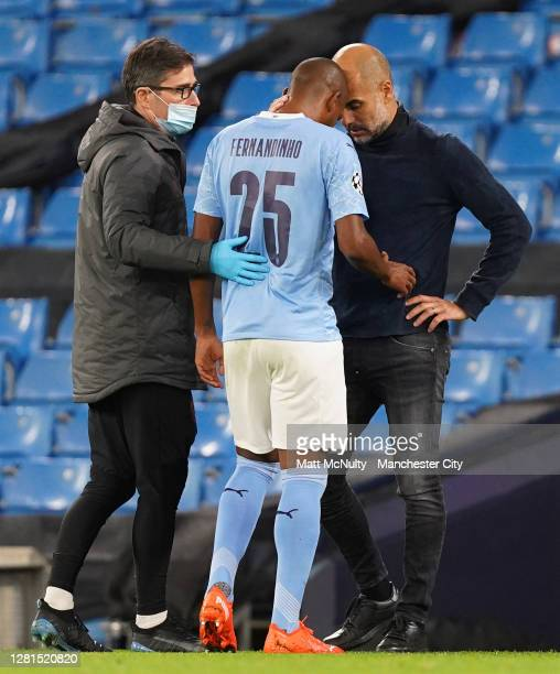 Pep Guardiola, Manager of Manchester City embraces Fernandinho of Manchester City who is substituted off during the UEFA Champions League Group C...