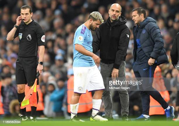 Pep Guardiola Manager of Manchester City embraces Sergio Aguero of Manchester City during the Premier League match between Manchester City and...