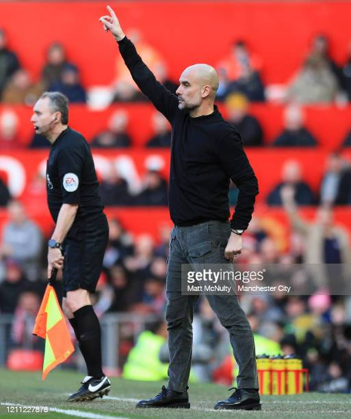 Pep Guardiola Manager of Manchester City gestures during the Premier League match between Manchester United and Manchester City at Old Trafford on...