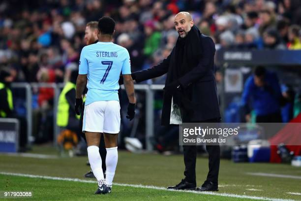 Pep Guardiola Manager of Manchester City gestures from the sideline as Raheem Sterling of Manchester City walks past him during the UEFA Champions...