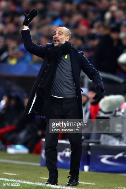Pep Guardiola Manager of Manchester City gestures from the sideline during the UEFA Champions League Round of 16 First Leg match between FC Basel and...
