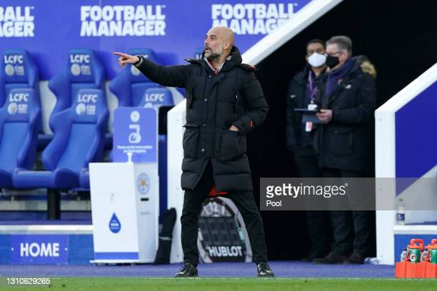 Pep Guardiola, Manager of Manchester City gives his side instructions during the Premier League match between Leicester City and Manchester City at...