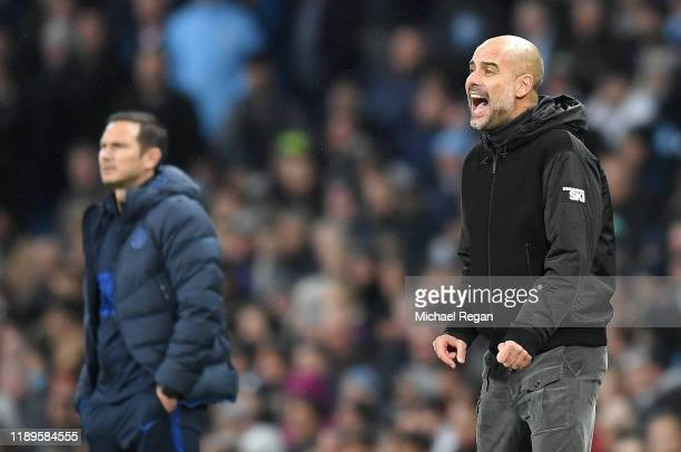 Pep Guardiola, Manager of Manchester City gives his team instructions as Frank Lampard, Manager of Chelsea looks on during the Premier League match...
