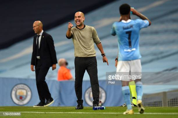 Pep Guardiola Manager of Manchester City gives his team instructions during the UEFA Champions League round of 16 second leg match between Manchester...