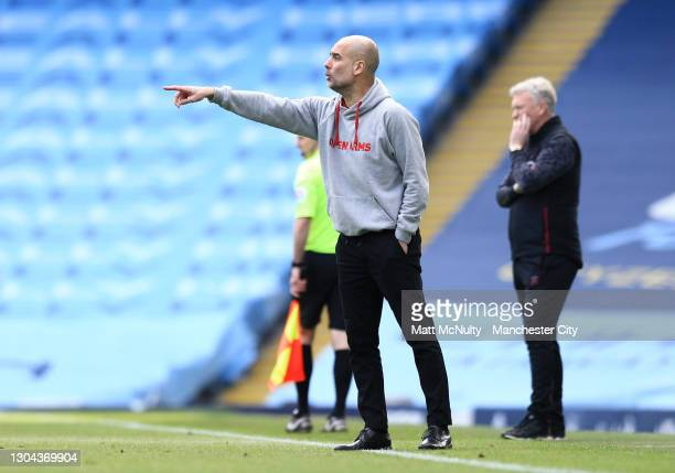 Pep Guardiola, Manager of Manchester City gives his team instructions during the Premier League match between Manchester City and West Ham United at...