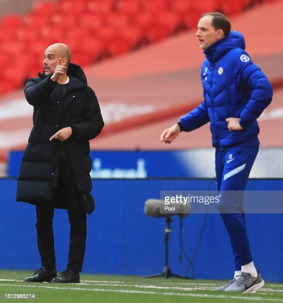 Pep Guardiola, Manager of Manchester City gives his team instructions during the Semi Final of the Emirates FA Cup match between Manchester City and...