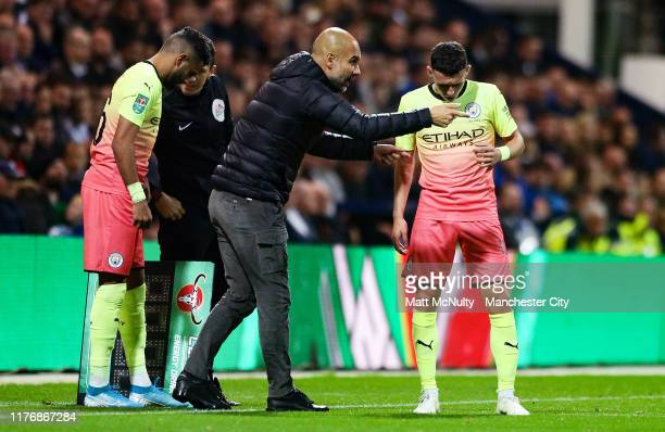 Pep Guardiola Manager of Manchester City gives instruction to Phil Foden of Manchester City during the Carabao Cup Third Round match between Preston...