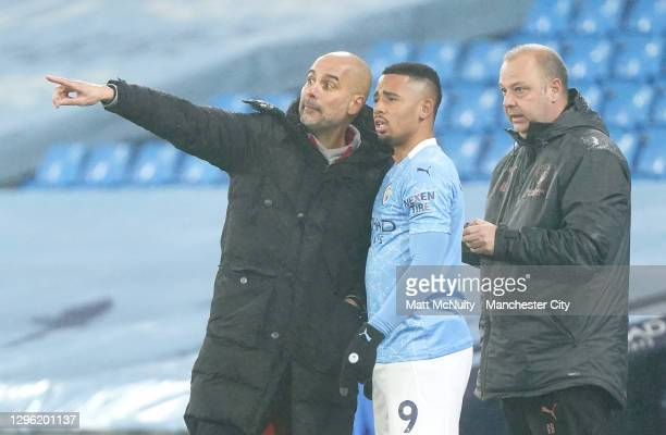 Pep Guardiola, Manager of Manchester City gives instructions to Gabriel Jesus of Manchester City who prepares to be substituted on during the Premier...