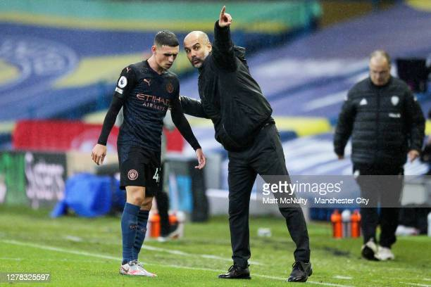 Pep Guardiola, manager of Manchester City gives instructions to Phil Foden during the Premier League match between Leeds United and Manchester City...