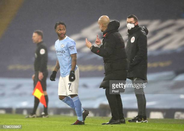 Pep Guardiola, Manager of Manchester City gives instructions to Raheem Sterling of Manchester City during the Premier League match between Manchester...