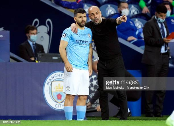 Pep Guardiola, manager of Manchester City gives instructions to Sergio Aguero during the UEFA Champions League Final between Manchester City and...