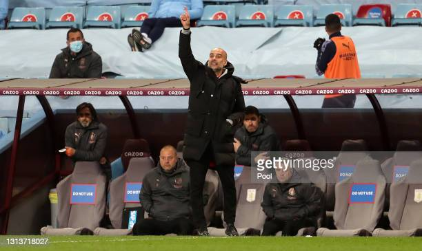 Pep Guardiola, Manager of Manchester City gives instructions to their side during the Premier League match between Aston Villa and Manchester City at...