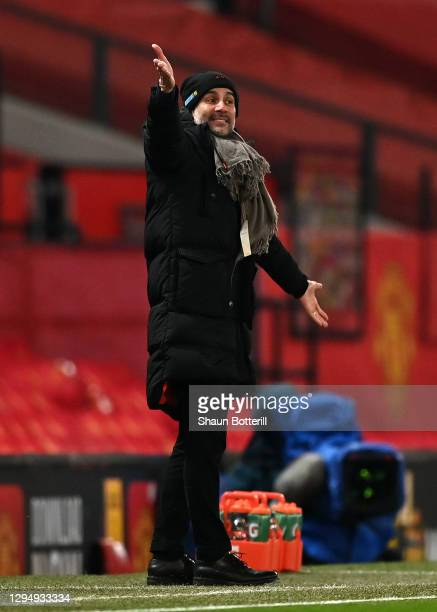 Pep Guardiola, Manager of Manchester City gives their team instructions during the Carabao Cup Semi Final match between Manchester United and...